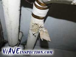 Asbestos insulation on steam heat piping. WAVE Home Inspector MA CT RI